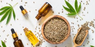 Cannabis oil and cannabis seeds at white